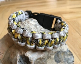 Paracord bracelet with whistle and fire starter