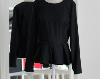 Blouse with basque hollow pleated peplum