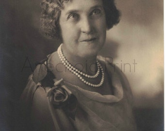 Vintage Sepia Portrait of Old Woman in Pearls