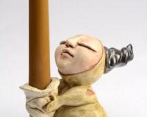 beige, horned ceramic figure candle holder