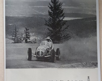1961 original Champion spark plugs Bobbie Unser sets new record Pikes Peak print ad.