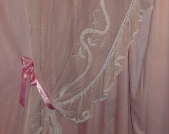 Former curtain tulle with applied ribbons