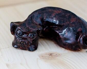 Little Pug lying