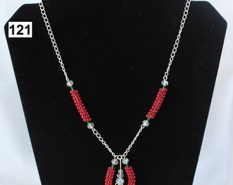 A Red and Green Horseshoe Shaped Coiled Necklace using Jewellery Wire and Clear Faceted Beads, Silver Coated Wire, Trefoil Wirework