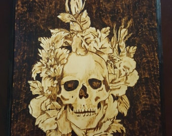 Skull and flowers woodburning