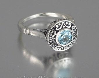 The SECRET DELIGHT 14k white gold Aquamarine engagement ring