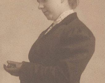 vintage photo 1910 Fashion Hat Woman Profile 3/4 view Puts on Glove