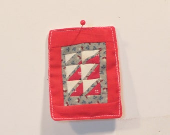 Miniature red wall quilt