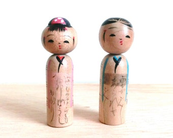 Antique miniture pair of kokeshi dolls - Pink and Green