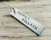 Secret Villain Aluminum Keychain- Funny Stamped Geek Villain Tag- Aluminum Silver Add on Tag