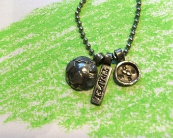 Travel necklace with globe and compass.
