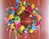 Springtime Wreath in Multi color flowers on Grapevine base
