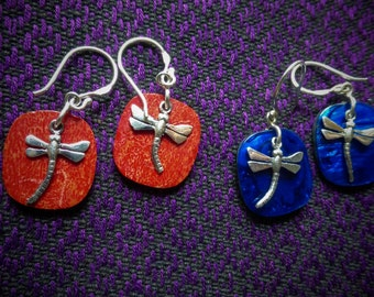 Silver dragonfly on coral, paua shell abalone, or mother of pearl