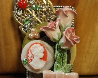 Assemblage jewelry mixed media found object wearable art vintage coral cameo porcelain rose brooch