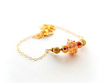 Gold Glass Bead Necklace. Bali Beads. Gold Focal Bead Necklace. Beaded Jewelry.