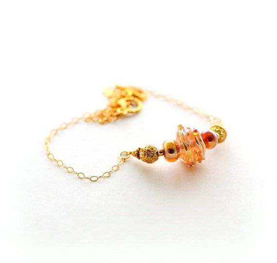 gold glass bead necklace bali gold focal bead