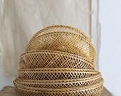 Vintage woven wicker nesting baskets