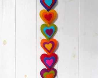 Colorful felt hearts wall hanging - 8 stuffed hearts