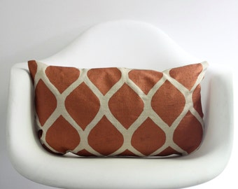 Aya lumber pillow cover hand printed in metallic copper on natural ecru organic hemp