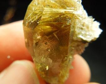 Rutilated Quartz w/ Hematite.