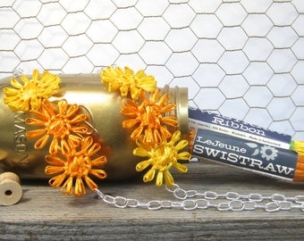 Sally long flower necklace woven in bright sunshine yellow and vibrant orange with vintage Swistraw by Ruby Buffalo.
