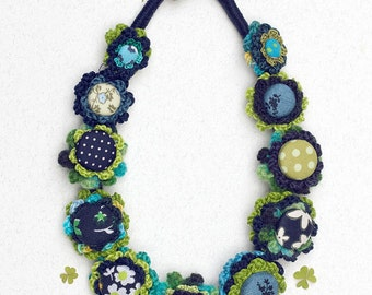 Floral crochet necklace in blue and green Fiber jewelry with fabric buttons, OOAK