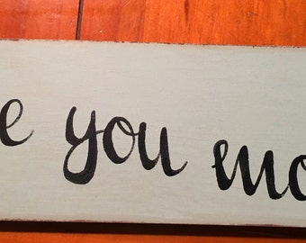 love you more hand painted distressed blue script font sign