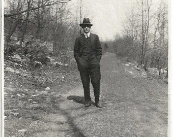 Old Photo Man wearing Suit and Hat Walking on Dirt Road 1920s Photograph snapshot Vintage