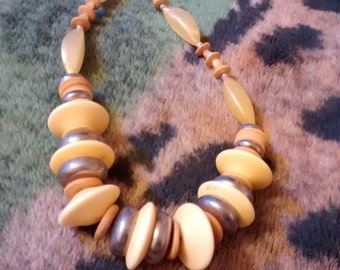 Yellow Metal/Wood/Lucite Beaded Disc Necklace  25 Inches Long