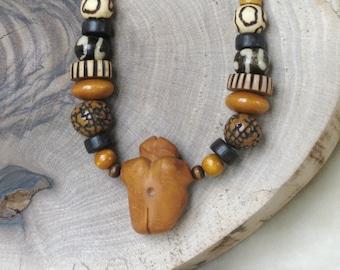Unique female Sculpture pendant beaded necklace - natural beads tone caramel brown black