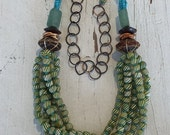 Spring.  5 strands of green striped African glass are paired with barkcloth beads and tumbled glass OOAK necklace by ladedDAH!