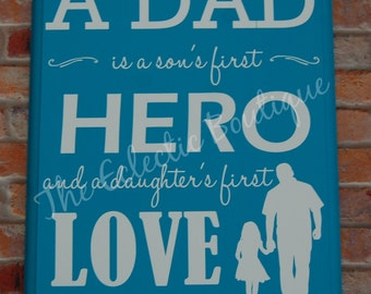 A dad is a son's first hero wooden sign