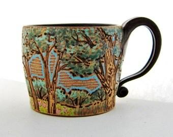 Four Seasons Mug, pottery mug, great christmas gift, tree art, nature art, holds approx 13 oz and is dishwasher and microwave safe.