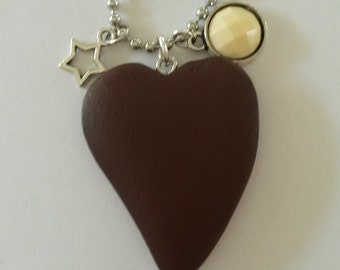 Ball chain necklace with a brown wooden heart pendant, a creamy cabochon and a star charm
