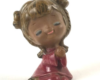 Vintage Sweet Little Girl Figurine Decor - Buns and Braids, Blue Eyelids, Black Eyelashes, Mauve Berry Dress - Sitting with Hands Clasped