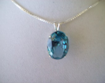 Lab Grown Aquamarine Pendant in Sterling Silver with chain 16x12mm