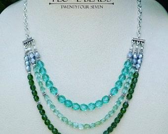 Triple stranded czech glass necklace in green-czech glass necklaces-multi strand necklaces-green statement necklace-green crystal necklace
