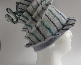 Striking and unusual felted hat in white, purple and greens