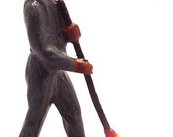Pride Lines Black Porter with Red Cap Lead Figure
