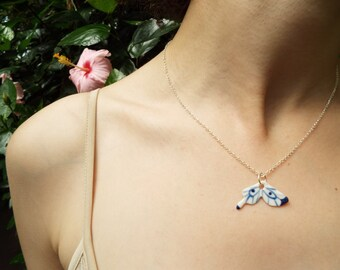 Porcelain blue and white butterfly wing necklace,  glazed and on a sterling silver 18'' chain