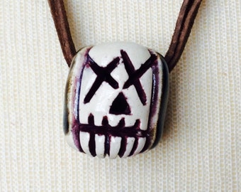 White skull bead// Purple X eyed skull face// bead with 4 holes// wear it two ways// large holed bead for para cord// layer with your faves