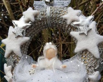 Needle felted Waldorf inspired fairy on Christmas wreath decorated with stars