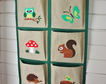 Kids organizer, hanging wall fabric pocket storage for books and toys, woodland