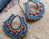 Peacock Earrings, brass teardrops with purple, teal, blue and orange accents, fan shaped earring