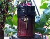 "MORRIGAN Warrior Goddess ""Old European Witchcraft""™ ""Fusion Magic""™ Black Over Burgundy Drippy Pillar Candle with Bronze Raven Skull Charm"