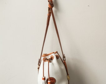 Dooney and Bourke Vintage drawstring handfitted bag