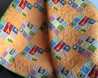 """Lions, Monkeys, Giraffes and More Are Altogether In This 39.75"""" X 42.5"""" Quilt"""