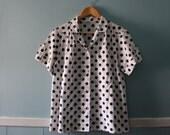 Women's vintage polka dot blouse / black and white short sleeve shirt / size medium to large