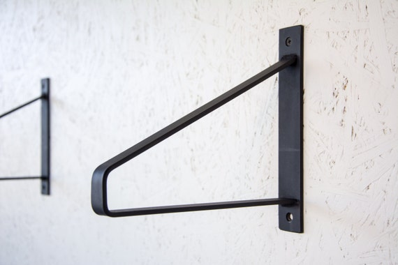 pair of black matte steel brackets newest design brackets. Black Bedroom Furniture Sets. Home Design Ideas