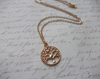 Gold tree charm necklace